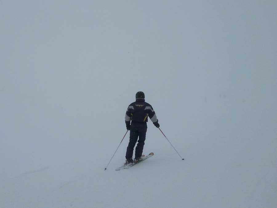 Rolf at the top of Angel in a whiteout
